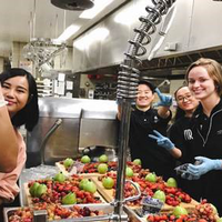 Students preparing fruit for Beauty and Beast themed meal