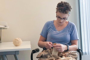 MSUAFRE PhD student Kelsey Hopkins works on a knitting project.