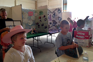 4-H Cloverbuds show off their projects at the county fair.