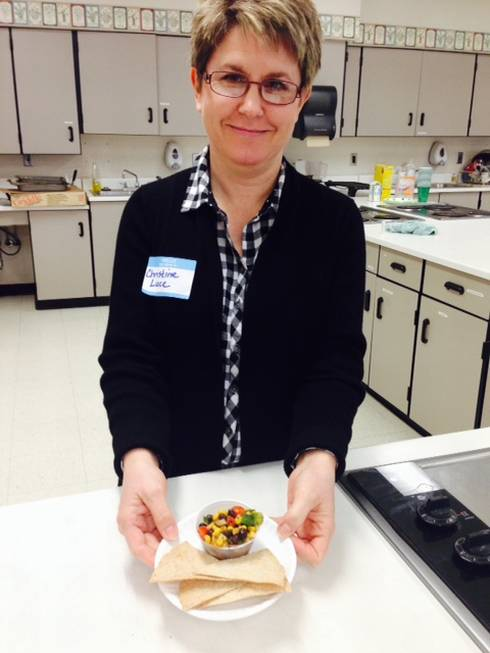 Food Service Director, Christine Luce shows off a sample of 'Cowboy Salad,' a prepared salad featured on the school salad bar that includes a mix of black beans, corn, tomatoes, peppers and herbs and spices.