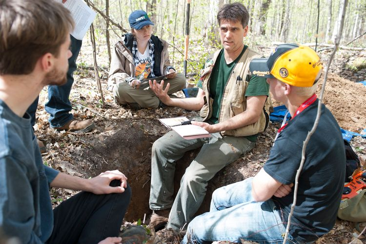 David Rothstein, professor in the MSU Department of Forestry, talks with students about forest soils during the Forestry Field Studies (FOR 420) course in summer 2017. Pictured left to right: Nick Russo, Taylor Hess, David Rothstein and Levi Churches.