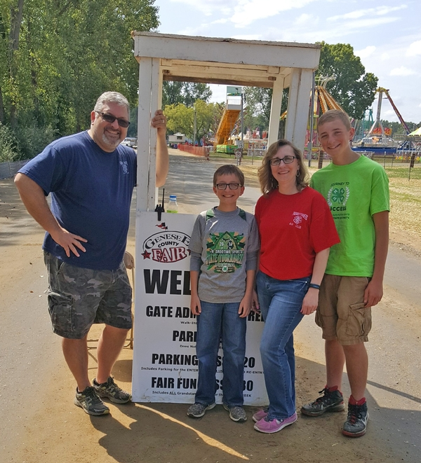 Jennifer Weichel and her family volunteering at the Genesee County Fair. Left to right: Larry, Jack, Jennifer and Andrew Weichel. Photo by Ken Turland.