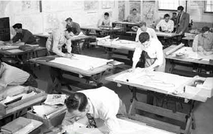 Photo of Landscape Architecture students working in a lab environment on drafting tables in MSU's old Quonset huts.