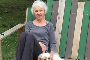 Photo of April Allen, assistant professor of interior design, with her dog.