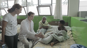Dr. Richard Gardner explains to MSU faculty member Dr. Julia Bello-Bravo treatment procedures of a patient in the CURE Children's Hospital In Ethiopia.