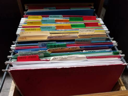 A filing cabinet of files for record keeping.