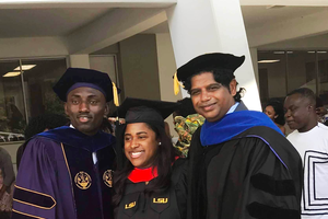 Emmanuel Kyereh (left) stands with fellow graduates from Louisiana State University.