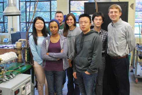 Christopher Saffron (far right) and his team of students are exploring ways to convert woody biomass into coal alternatives.