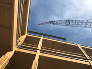 View looking up at the mass timber beams being installed at the STEM Teaching and Learning Facility on the campus of Michigan state University.