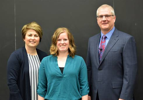 CANR Senior Associate Dean Kelly Millenbah and CANR Dean Ron Hendrick present the Excellence in Graduate Student Teaching Award to Carley O'Malley (center) from the Departments of Animal Science.
