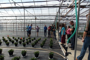e-GRO team members and graduate students from around the country touring a western Michigan greenhouse operation