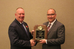 Dr. J. Richard Pursley receiving the 2018 NAAB Research Award from NAAB Board Chairman, Chuck Sattler.