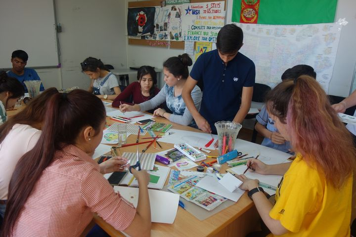 Turkmenistan visitors draw pictures for the international art and handcrafting project.