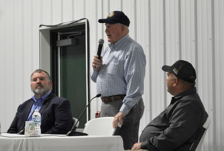 Sonny Perdue (center) answers questions from farmers at the Saginaw Valley Research and Extension Center. The town hall was moderated by Michigan Farm Bureau President Carl Bednarski (left). Zippy Duvall (right), president of the American Farm Bureau Federation, also answered audience questions.