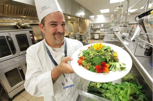 Hospital Chef Steve Delidow showing off a dish made with ingredients from the greenhouse. (Photo Credit: Patricia Beck/DFP).