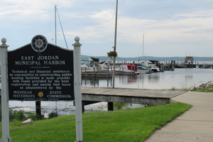 A sign in front of a boat dock
