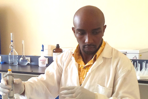 Kizito Nishimwe working in a lab