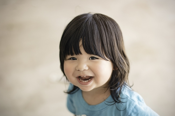 Some children naturally have a happier mood, and other children may have a more serious mood.