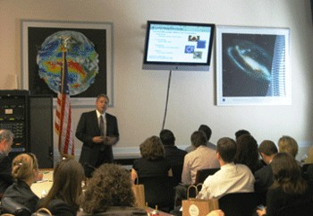 Doug Landis presents information to legislators and their staff members in Washington, D.C.