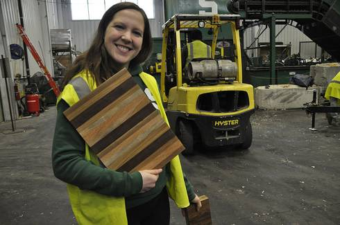 MSU student Tiffany Pupa shows off the countertops made at MSU for the Sparty's Cabin project