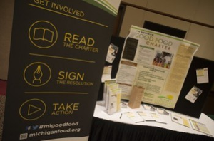 The Michigan Good Food Charter information table at the 2014 Good Food Summit in Lansing.