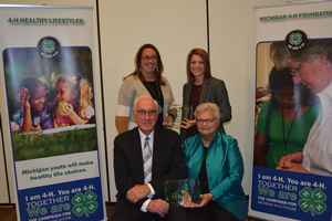 GreenStone Farm Credit Services representatives with Dale and Sara Stuby receiving Michigan 4-H Citation Awards.
