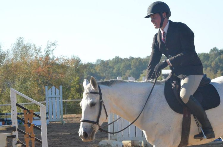 Co-author Caleb Charles showing on MSU's IHSA Hunt Seat Equestrian Team.