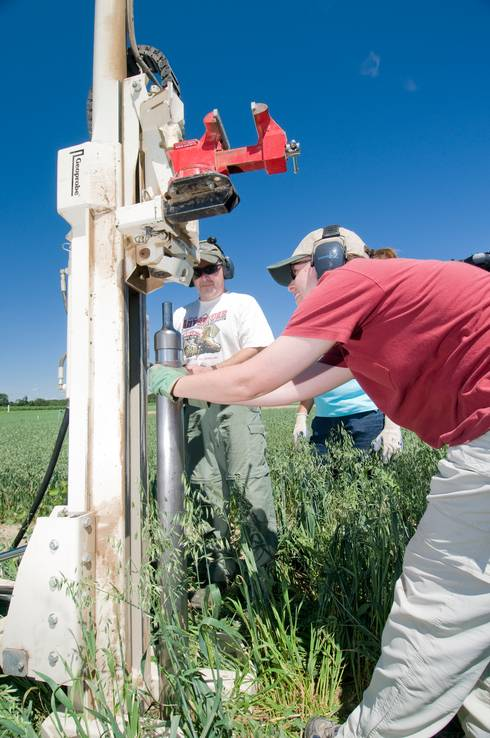 Researchers at Kellogg Biological Station collect soil cores for soil carbon analysis.
