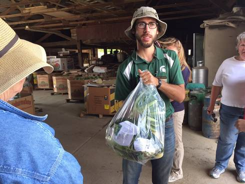 MSU Extension educator Ben Phillips at Van Houtte Farms with Farm to Factory bag