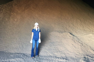 Madi Heath at standing in front of grain at her summer internship.