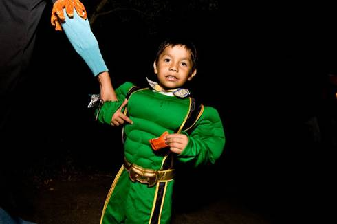 Child dressed in superhero costume for Halloween. | Photo courtesy of Flickr user Charlie Llewellin.