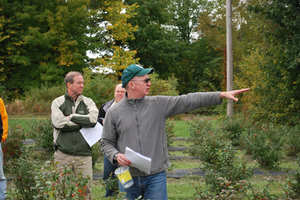 MSU entomologist Rufus Isaacs talks with growers at the 2014 Trevor Nichols Research Center Field Day.