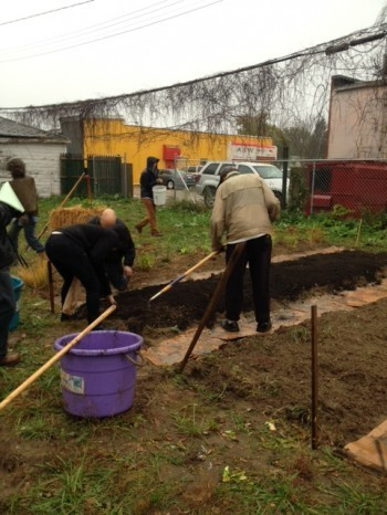 Volunteers hard at work to build the A & W Daycare garden. Photo courtesy of Julia Smith.