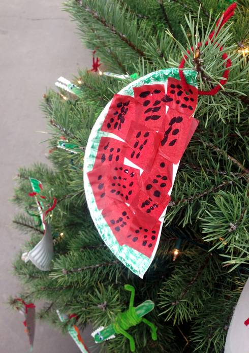 "A child drew a watermelon slice, which was inspired by the book, ""The Watermelon Seed"" by Greg Pizzoli."