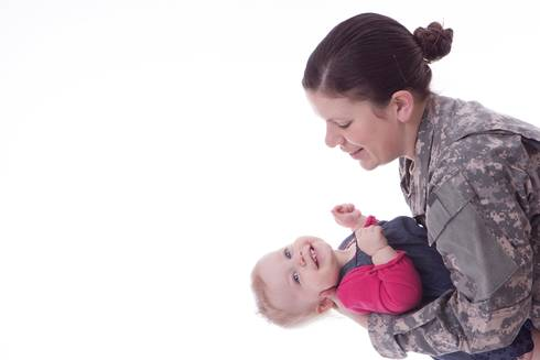 Military mom holding baby