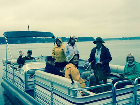 Volunteers on board seeking out their first Exotic Aquatic Plant Watch on Eagle Lake. Photo credit: Michael Mroczek