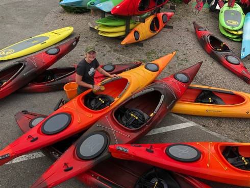 Audrie Adams works as an intern at a kayak outfitting business
