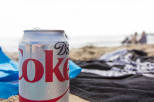 Diet coke can open on beach.
