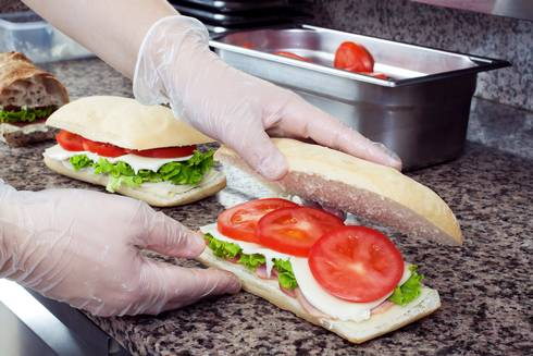 Sandwiches are prepared following food safety guidelines.