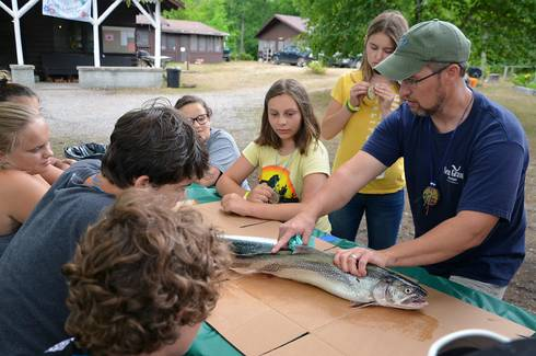 Michigan Sea Grant Extension educator Brandon Schroeder was honored recently with an MSU Distinguished Staff Award. In this picture, he is shown working with campers attending the 2018 4-H Great Lakes Natural Resources Camp. He is one of the co-leaders of the camp. Photo credit: Michigan Sea Grant