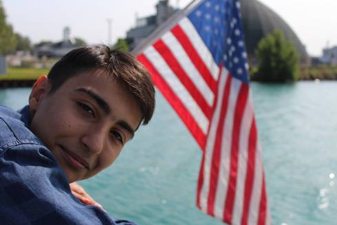 Artyom, a 4-H academic year-long exchange student from Armenia, is enjoying a cruise on Lake Huron during his Michigan exchange experience. Photo by D'Ann Rohrer, MSU Extension.