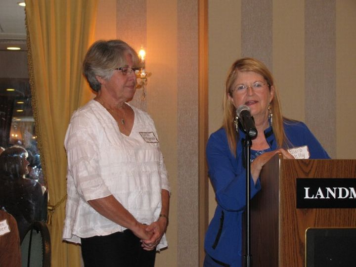 Advanced Master Gardener Carol Fitzgerald (left) accepts the 2015 Phil Niemisto Volunteer Award from Barb Kelley (right), awards committee chair of the Marquette Beautification and Restoration Committee. Photo by Tami Dawidowski.