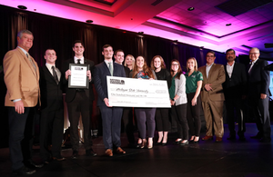 Photo of Construction Management faculty and students receiving the the Homebuilding Education Leadership Program grant award from the National Housing Endowment.