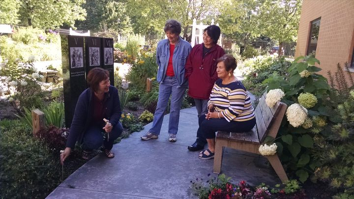 Advanced Master Gardener Sue Wanic (left) works with other Master Gardeners (left to right) Greta Arntzen, Debbi Stearns and Sue Shepich in the Serenity Garden at St. Francis Hospital. Photo: Rebecca Krans, MSU Extension.