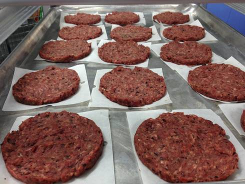 Blended beef and bean burger patties laid out on a metal tray