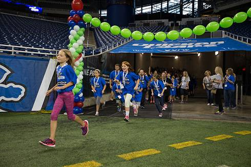 Engaging students in a motivating, energy-packed day full of fun, movement and learning at Ford Field to celebrate a healthy school year with Fuel Up to Play 60.