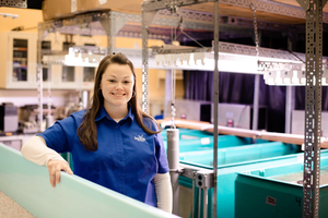 Dr. Lauren Jescovitch is shown standing inside a research area at the Great Lakes Research Center. Photo: Michigan Tech