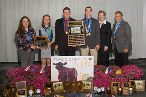 Participants of the 2014 4-H Dairy Judging Team at World Dairy Expo displaying the great rewards of partaking in animal judging activities.