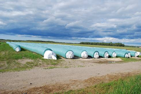 Tube line wrapped baled silage at Eric and Penny Wallis' farm near Rudyard, MI.