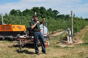 MSU researcher Matthew Grieshop demonstrates a solid set canopy delivery system.